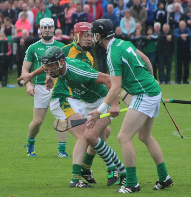 Ballyduff's, Dougie Fitzell, comes away with possession. Photo by Gavin O'Connor.
