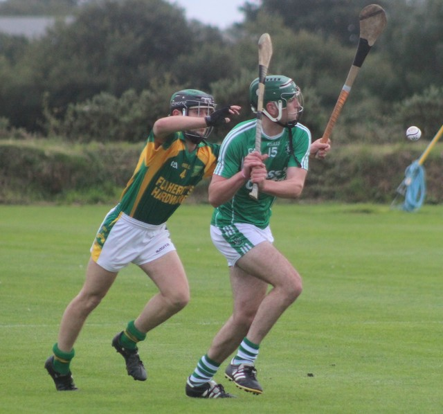 Ballyduff's, Eoin Ross, tries to get a shot away while Kilmoyley's, Shane Nolan, attempts the block. Photo by Gavin O'Connor.