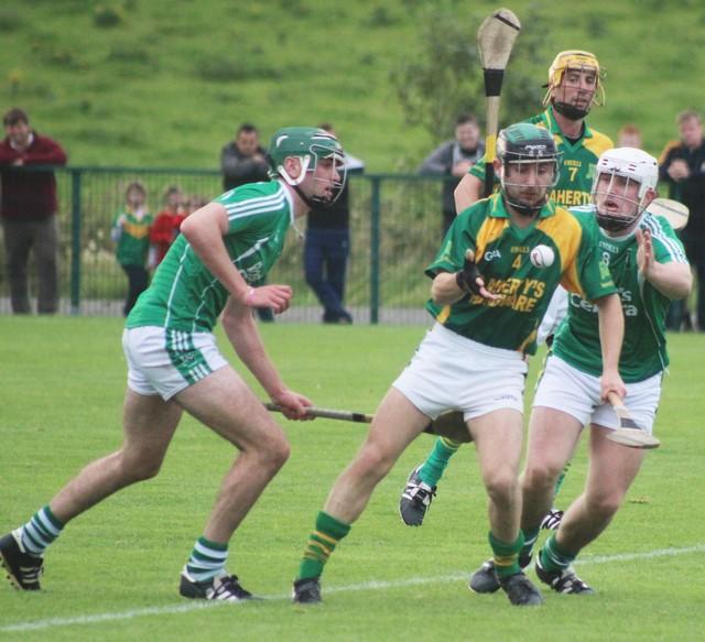 Kilmoyley's, Sean Nolan, clears the ball under pressure. Photo by Gavin O'Connor.