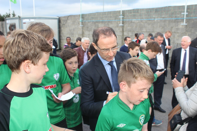 Martin O'Neil signing shirts for kids in Mounthawk Park. Photo by Galvin O'Connor.