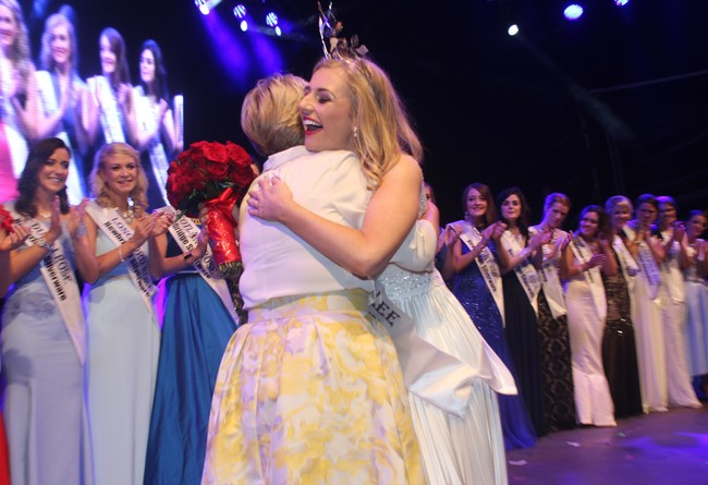 Elysha Brennan, is greeted on stage by her mother. Photo by Gavin O'Connor.