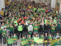 Kerry senior star, Marc O'Se along with Kerry minors, Jack Morgan, Michéal	Reidy and Eoin O'Brien, with staff and students in the school on Monday morning for their 'Jersey Day'. Photo by Gavin O'Connor.