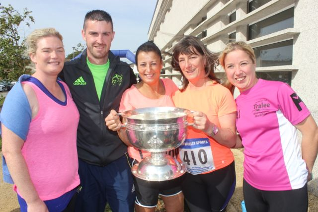 Niamh O'Sullivan, Colin Aherne, Mandy Hudson, Anne Curtin and Carol O'Hanlon with the Tommy Markham Cup at the CBS 5k and 3k Fun Run at the school on Sunday. Photo by Dermot Crean