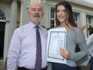 Principal of Gaelcholáiste Chiarraí, Austin Ó Seachnasaigh with Róisín Ní Churraí who received 11 A grades in her Junior Cert results on Wednesday morning. Photo by Dermot Crean