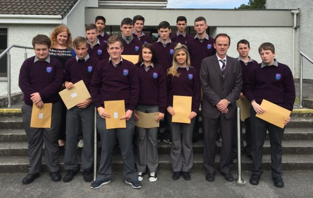Principal Richard Lawlor with students holding their Junior Cert results at Coláiste Gleann Lí on Wednesday.