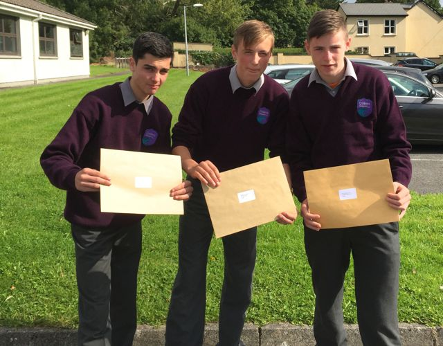 Zeeshan Baig, Culán Sweeney and Ian McCoy with their Junior Cert results at Coláiste Gleann Lí on Wednesday.