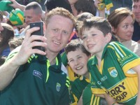 Paudie O'Connor and Cillian O'Shea, Dromid, with Colm Cooper at the Kerry GAA open day at Fitzgerald Stadium on Sunday. Photo by Dermot Crean
