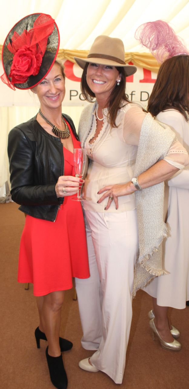 Mary Russell and Trish Moore, Kildare, enjoying Ladies Day at Listowel Races on Friday. Photo by Dermot Crean