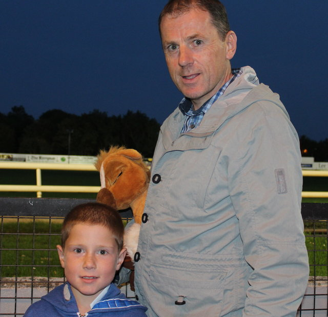 Peter and Ben Murphy enjoy the Mitchels GAA Club night at the dogs on Saturday night. Photo by Fergus Dennehy.