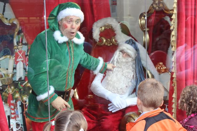 Alfie Elf spots Santa Claus asleep in the window at the launch of Santaland at CH Chemists on Saturday afternoon. Photo by Dermot Crean