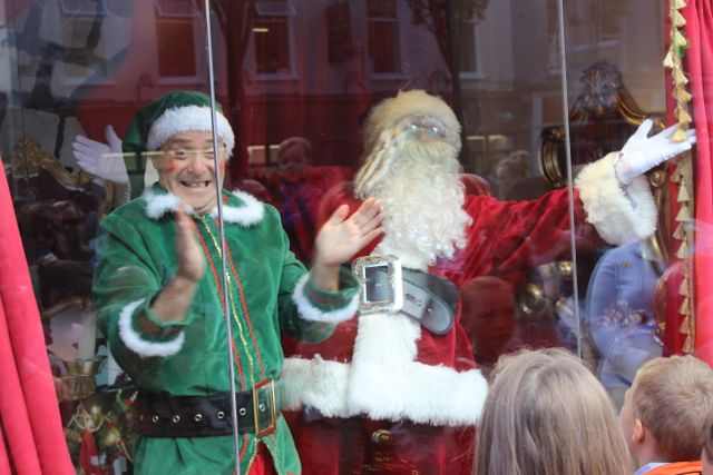 Alfie Elf and Santa in the window at the launch of Santaland at CH Chemists on Saturday afternoon. Photo by Dermot Crean