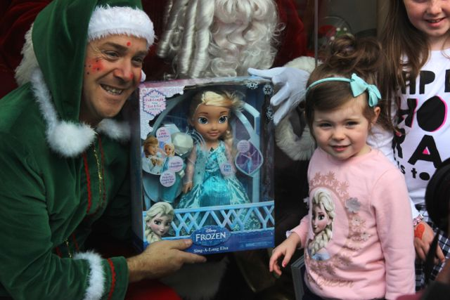 This little lady looks impressed with the Elsa doll held by Alfie Elf at the launch of Santaland at CH Chemists on Saturday afternoon. Photo by Dermot Crean