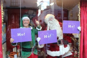 Santa Claus and Alfie Elf in the front window at the launch of Santaland at CH Chemists on Saturday afternoon. Photo by Dermot Crean