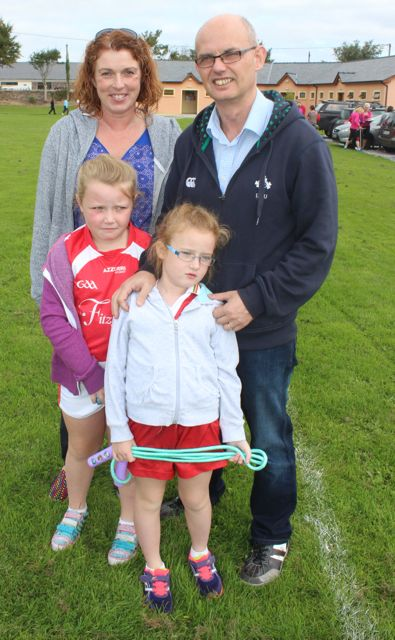 Miriam Mangan and John Breen with Gráinne and Maebh Breen at the St Pat's GAA family fun day on Sunday. Photo by Dermot Crean
