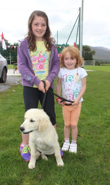 Orla and Niamh Murphy with 'Jessie' at the St Pat's GAA family fun day on Sunday. Photo by Dermot Crean
