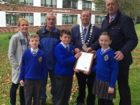 At the presentation of a Tidy Town award to CBS Primary were, front from left: Alex Clifford, Cody O Sullivan and Lauren McGillycuddy. Back: Niamh O Dowd, David Magnier, Thomas McEllistrim and Denis Coleman.