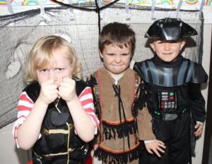 Junior infants Rory O'Brien, Darragh Cronin and Wiktor Kopec having fun at Blennerville NS on Friday. Photo by Dermot Crean
