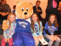 'Garvey the Bear' with Grace Reilly, Laura Reilly and Aisling Casey, at the Team Garvey's game on Saturday evening at Mercy Mounthawk gym. Photo by Dermot Crean