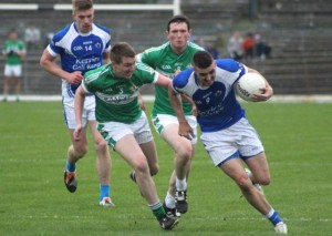 Kerins O'Rahilly's midfielfer, Con Barrett, tries to power through in last year's senior county championship quarter-final loss to Legion. Photo by Dermot Crean.