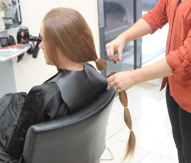 The point when Rachel's 14 inch long pony tail was cut. Photo by Gavin O'Connor.