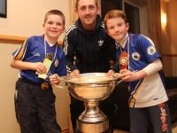 Dan Moloney and Donnacha Buttimer with Kerry Senior captain, John Griffin, with The Christy Ring Cup.