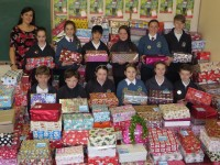 Launching the Scoil Eoin Team Hope Christmas Shoebox Appeal were, from left, back: Mrs. Carol Anne O'Donoghue Student Council Co ordinator, Aoibheann Griffin, Eimear Litchfield, Mengyao Ni, Katie McEvoy, Grace O'Mahoney and Dan Enright. Front: Matas Balsys, Jake Moriarty, Katie Prendiville, Faith Russell, Ciara O'Mahony, and  Jack Doyle.