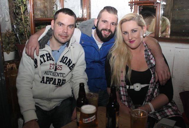Thomas O'Donoghue, Tommy O'Neill and Rose Quirke at the table quiz in aid of Sera Husky Animal Rescue in Roundy's Bar on Thursday night. Photo by Dermot Crean