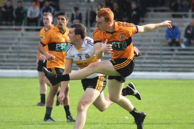 Shane O'Callaghan shoots at goal with Miike Maloney watching on. Photo by Dermot Crean.