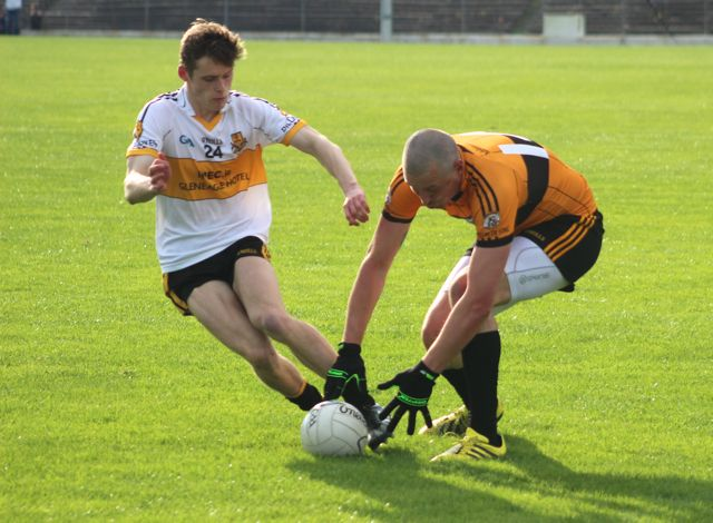Kieran Donaghy goes down for a ball closely watched by Gavin White. Photo by Dermot Crean.