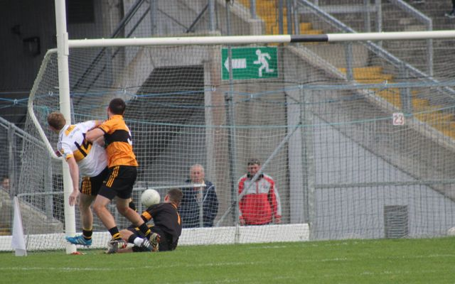 Colm Copper slips the ball into the net passed Austin Stacks goalkeeper, Darragh O'Brien. Photo by Dermot Crean.