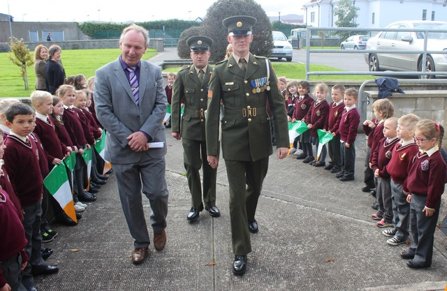 Holy Family Principal, Ed O'Brien, leads Sgt Chris Hore and Gnr James Power into the school. Photo by Gavin O'Connor.