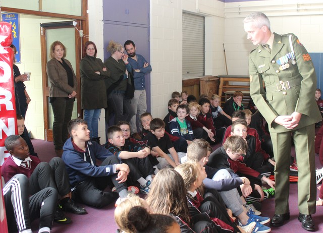 Sgt Chris Hore answers a question from a pupil in Holy Family.