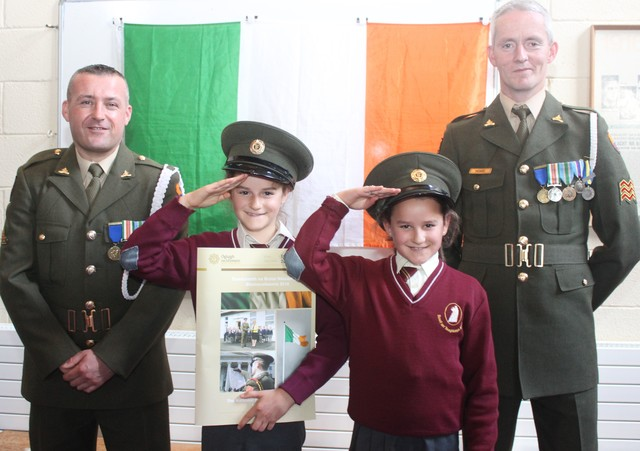 Holy Family school children, Maria and Anna Draghici, with Gnr James Power and Sgt Chris Hore. Photo by Gavin O'Connor.