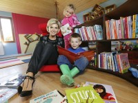 Non Repro Fee. 07.10.2015 Bord Gáis Energy's Donate a Library ambassador Lisa Duffy pictured with Denas Valasinas, age 5 and Chloe Ratty, age 4 at the Daoine Óga Community Childcare in Navan, Co. Meath as Daoine Óga became  the first organisation to receive a library in 2015. The programme sees the energy company give away libraries to community groups and charities all over Ireland. The charities are nominated by the public and anyone can nominate at www.bgebookclub.ie Pic. Robbie Reynolds