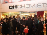 Some of the crowd outside CH Chemists for the Customer Night on Friday. Photo by Dermot Crean