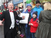 Kevin Reardon of CH Chemists getting the crowds in full voice for Santa at the CH Chemists' Santa Parade on Saturday. Photo by Dermot Crean