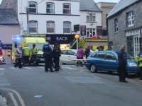 Man Taken To Hospital After Car Veers Off Street In Town Centre