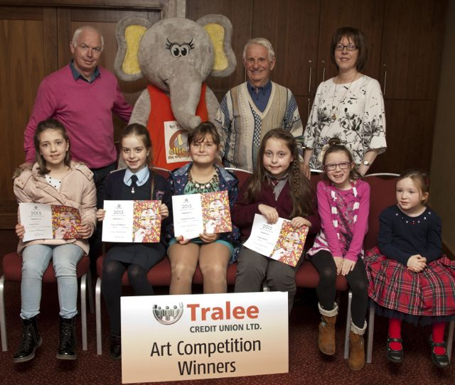 Art Competition Winners: Laura West, Scoil Nuachabhail Ballymac, Lauren O'Sullivan, Ardfert National School, Airida Mateviciute, Scoil Mhuire Killorglin, Niamh Murphy, Knockaclarig National School, Brosna, Sarah Murphy, Scoil Mhuire Killorglin and Mary McKenna Scoil Mhuire Killorglin Back Row, Tralee Credit Union, Fintan Ryan CEO, Ellie The Elephant, Tom Lawlor Chairman and Mary O'Connell Director.