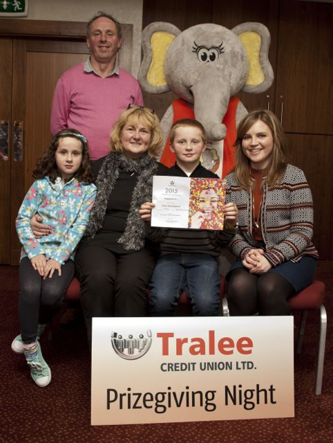 Art Competition Winner Fionn Bermingham from Holy Family Tralee with his mum Patricia and sister Bronagh, Teacher, Alannah Moriarty, Mr O'Brien Principal and Tom Lawlor TCU Chairman.