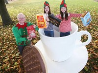 Joe Smith (Lions Club Coordinator) and twin sisters Millie & Sophie Bolger urge customers to double their efforts and 'give big' at the launch of this year's Christmas Food Appeal in association with the Lions Club and Tesco Ireland.