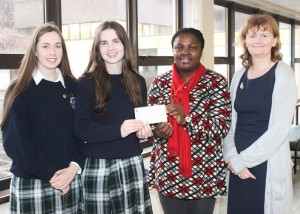 Presentaion Secondary School students, Niamh Myers and Mairead Dowling had over a €600 cheque to Theresa Elumelu of Tralee Internationl Resource Centre, with teacher, Brid Prenderville. Photo by Gavin O'Connor.