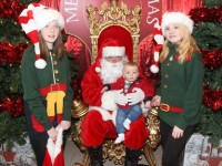 Little David Browne from Castleisland, meeting Santa Claus with elf helpers Ellie and Emer Forde, at Manor West on Saturday afternoon. Photo by Dermot Crean