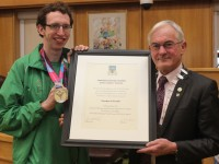 Brendan O'Connell, receiving a citation to mark his civic reception from Mayor of Kerry, Cllr Pat McCarthy. Photo by Gavin O'Connor.