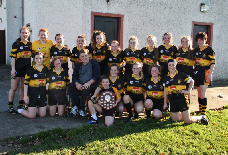 North Kerry Intermediate Ladies Football Champions - Austin Stacks team with their mascot, Holly, and team mentors. Photo by Adrienne Mc Loughlin.