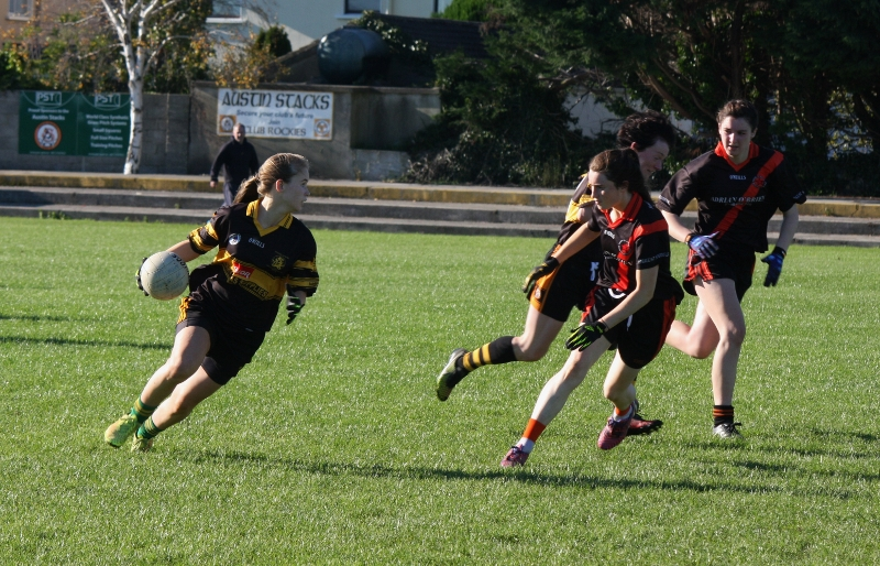 Austin Stacks players Mollie O'Carroll about to pass ball off to Marina Barry. Photo by Adrienne Mc Loughlin.