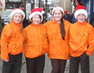Gaelscoil mhic Easmainn Christmas carolers in the Mall on Wednesday afternoon were, from left: Ailbhe Ni Dhalaigh, Joshua De Roiste, Vivian Ni Dhunnin, Conal O Clumhain. Photo by Gavin O'Connor.