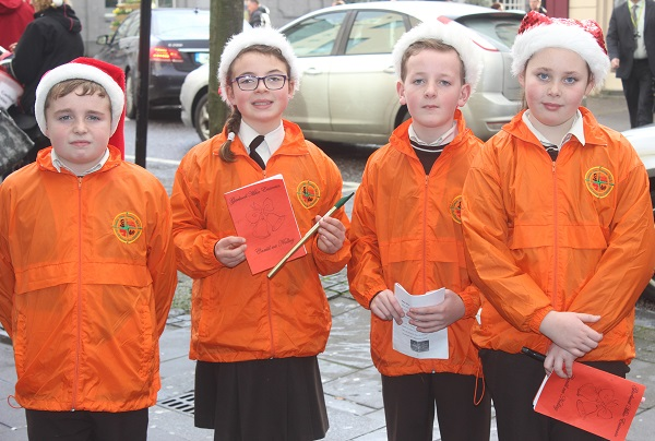 Gaelscoil mhic Easmainn Christmas carolers in the Mall on Wednesday afternoon were, from left: Joseph O Suilleabhain, Amy Nic Seoin, Niall O'Se, Saoirse Ni Bhraoin. Photo by Gavin O'Connor.