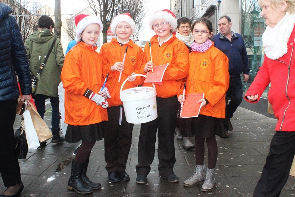 Gaelscoil mhic Easmainn Christmas carolers in the Mall on Wednesday afternoon were, from left: Siun Ni Chlumhain, Aisling Ni Chathasigh, Ciara Ni Gheirain and Aoibheann Ni Stafford. Photo by Gavin O'Connor.