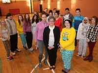 Breda Dyland from the Kerry Cancer Support with KDYS students who took part in a pyjama morning in aid of the Kerry Cork Link Bus.