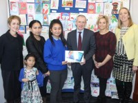 Jeannie Bobiles of Castleisland Community College accepts her prize from Colm McEvoy CEO of Kerry ETB after winning the Kerry ETB Christmas Card Competition. Also included, from left; Principal of Castleisland Community College, Carmel Kelly; Jeannie's mother Teresita and sister Jillian, art teacher at Castleisland Community College, Pia Thornton and Teresa Lonergan,  Deputy Principal. Photo by Dermot Crean